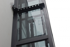 Outside Lift in Smoked Glass Shaft
