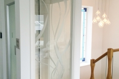 Glass Home Lift in White Structure