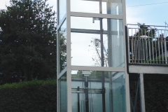Outdoor Home Lift in Complete Glass Structure with walkway