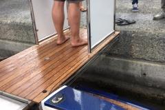 Talisman as it meets dock with guard rails