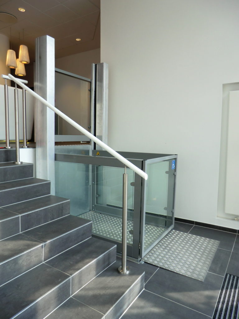 Glass Step Lift in Office Entrance