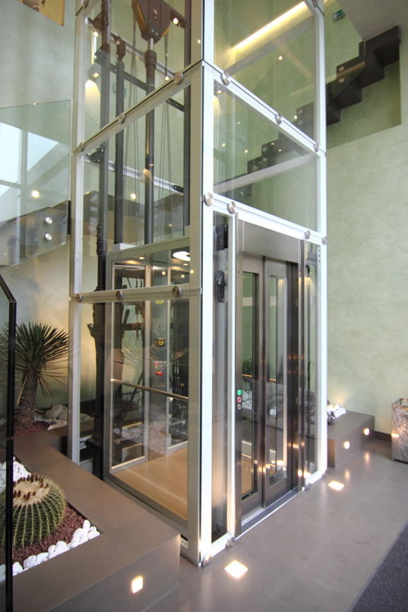 Fully glazed lift in lobby