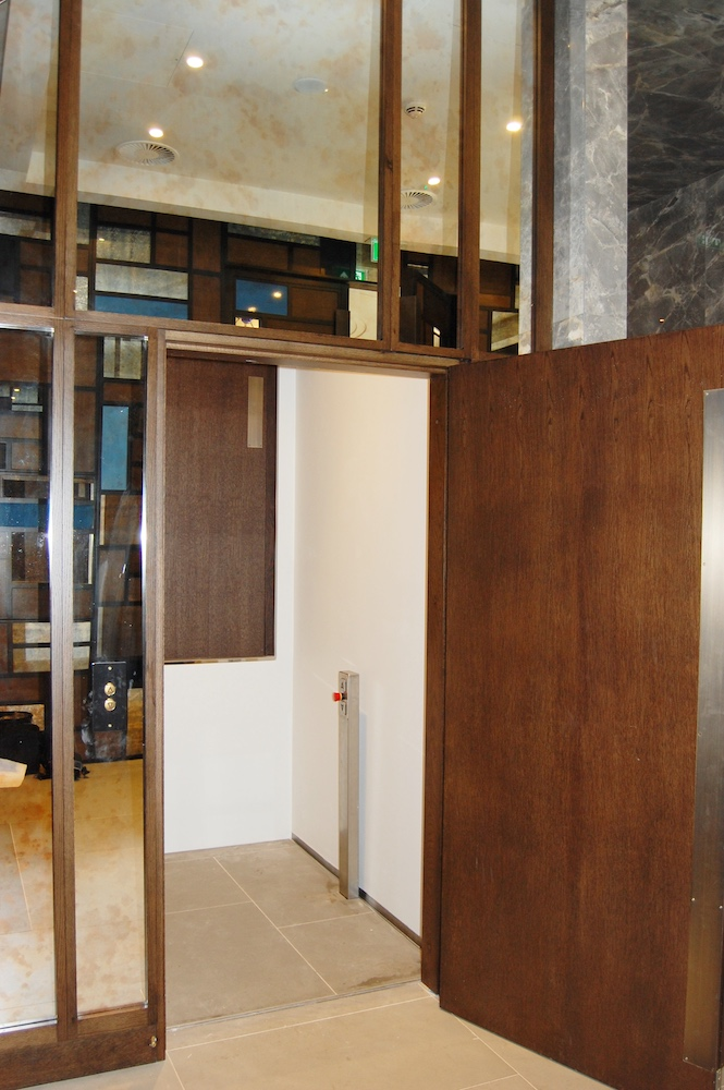Hidden platform lift at the Devonshire Club linking the entrance with the bar