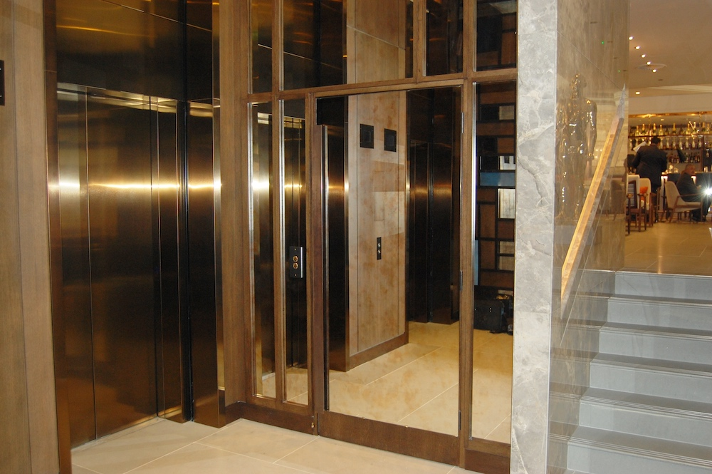 Hidden lift at the bar entrance at the Devonshire Club, London