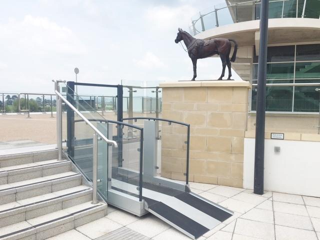 The glass platform lift at Cheltenham Racecourse