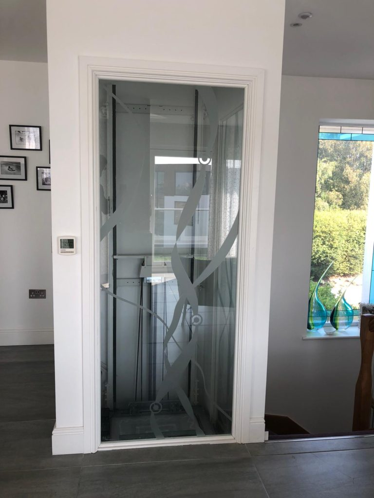 Lift shaft with glass panels