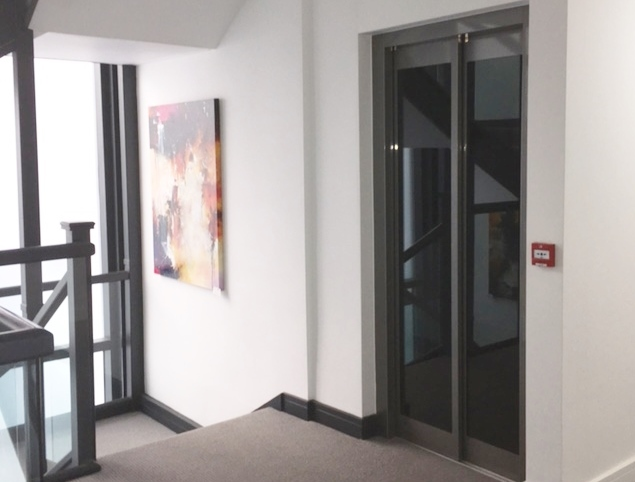 Lift with automatic glass doors in block of flats in Weymouth
