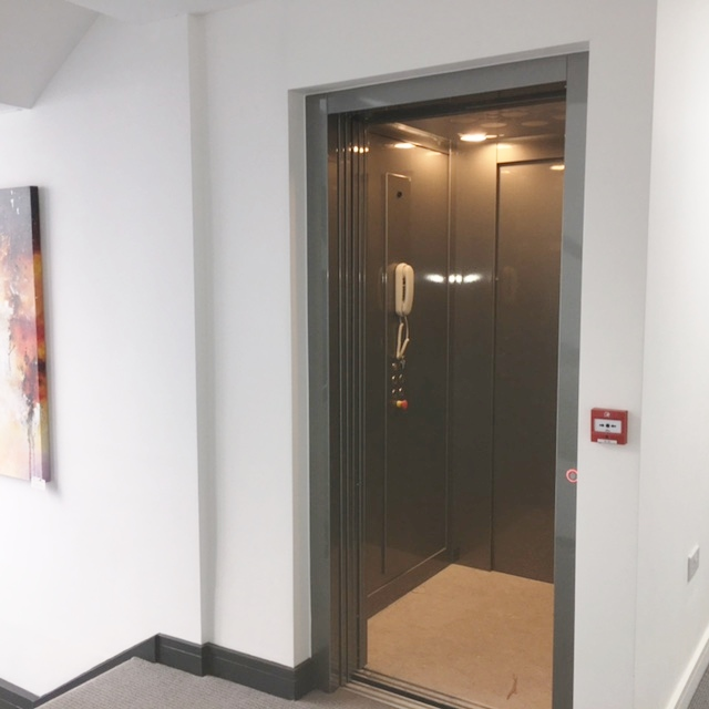 Doors open to the lift in the apartment block in Weymouth