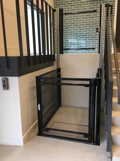 Platform lift with specialist black mesh