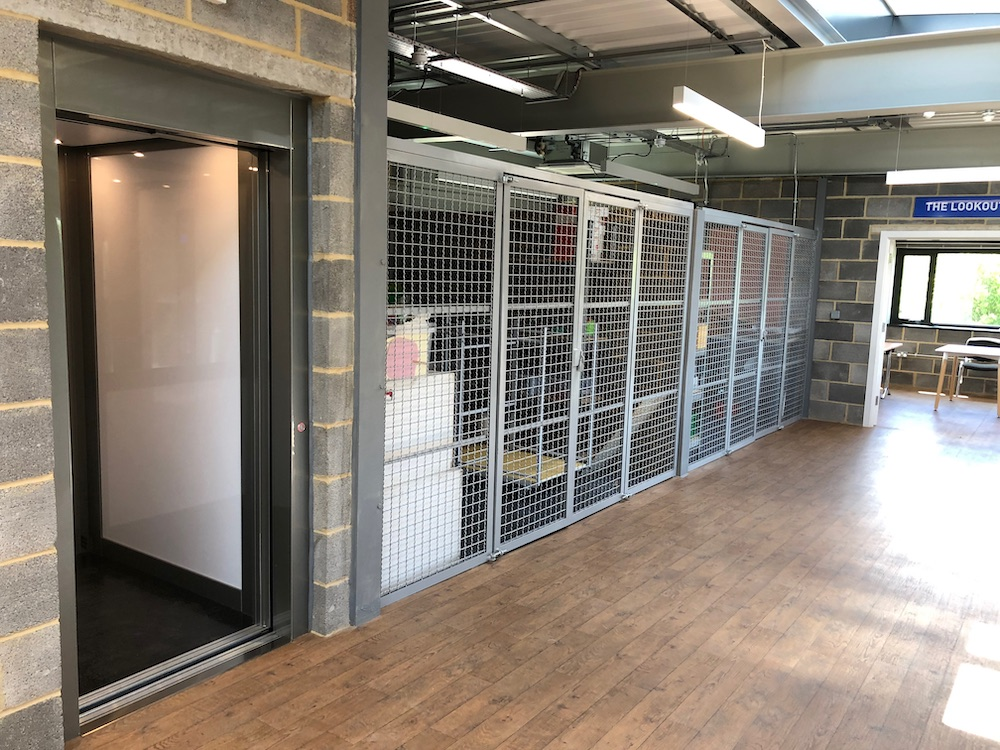 Lift with open sliding doors on 1st Floor at The Base, Greenham Business Park