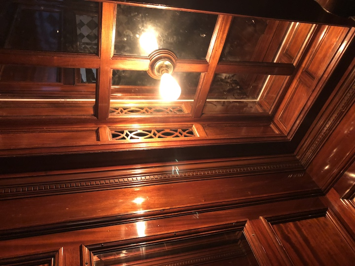 Mirrored light-box in the antique passenger lift