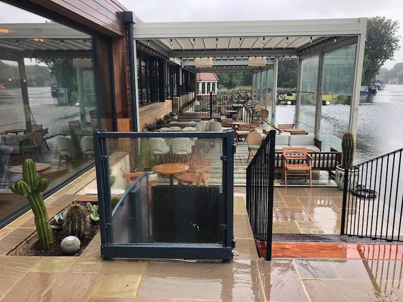 Wheelchair lift overlooking the covered terrace at The Swan at Streatley
