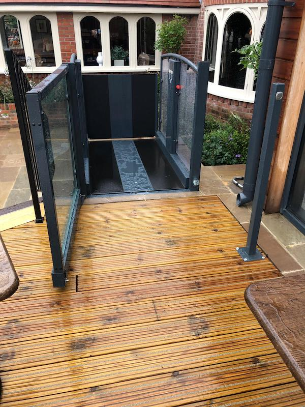 Outside platform lift linking the function room with the lower terrace