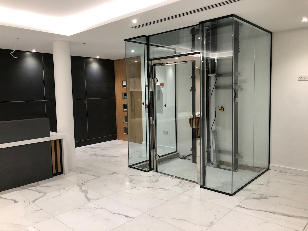 Glass lift shaft in the main reception at Sovereign House