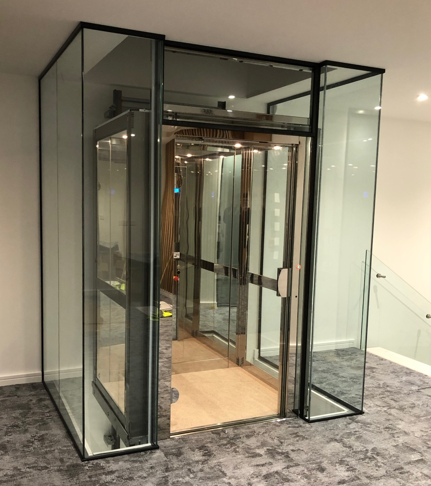Glass platform lift from the first floor of Sovereign House office building