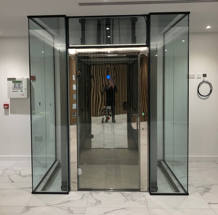 Glass platform lift in new commercial offices in Essex