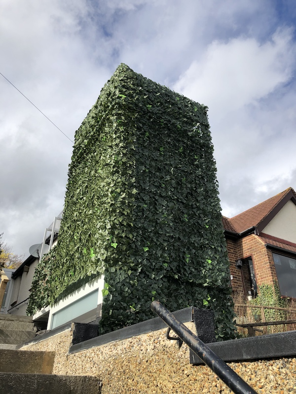 The lift structure was covered in foliage-like screening to match the surroundings bushes and climbers