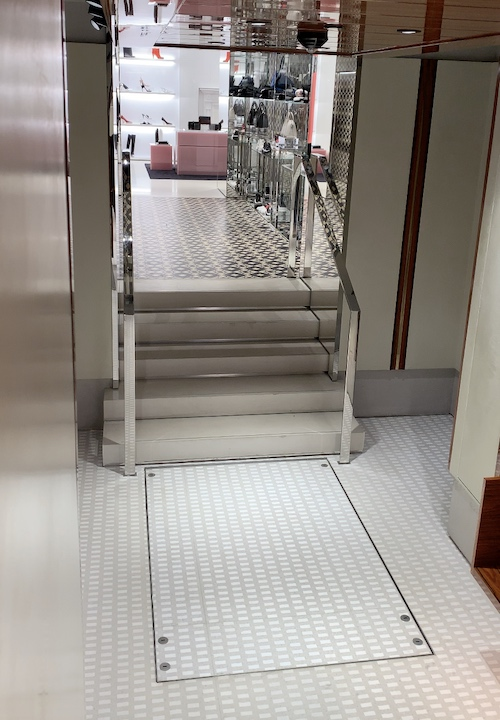 Without the handrails the hidden lift recesses into the ground and allows other visitors to use the steps as normal