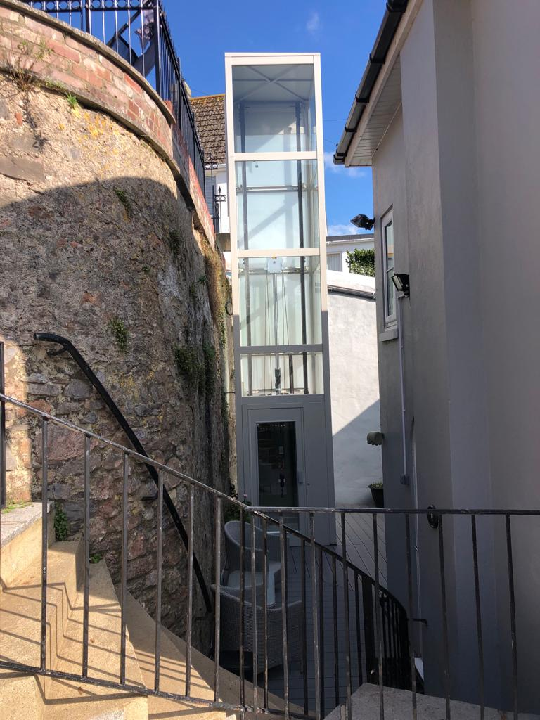 This external home lift travels over 7 metres across 3 floors