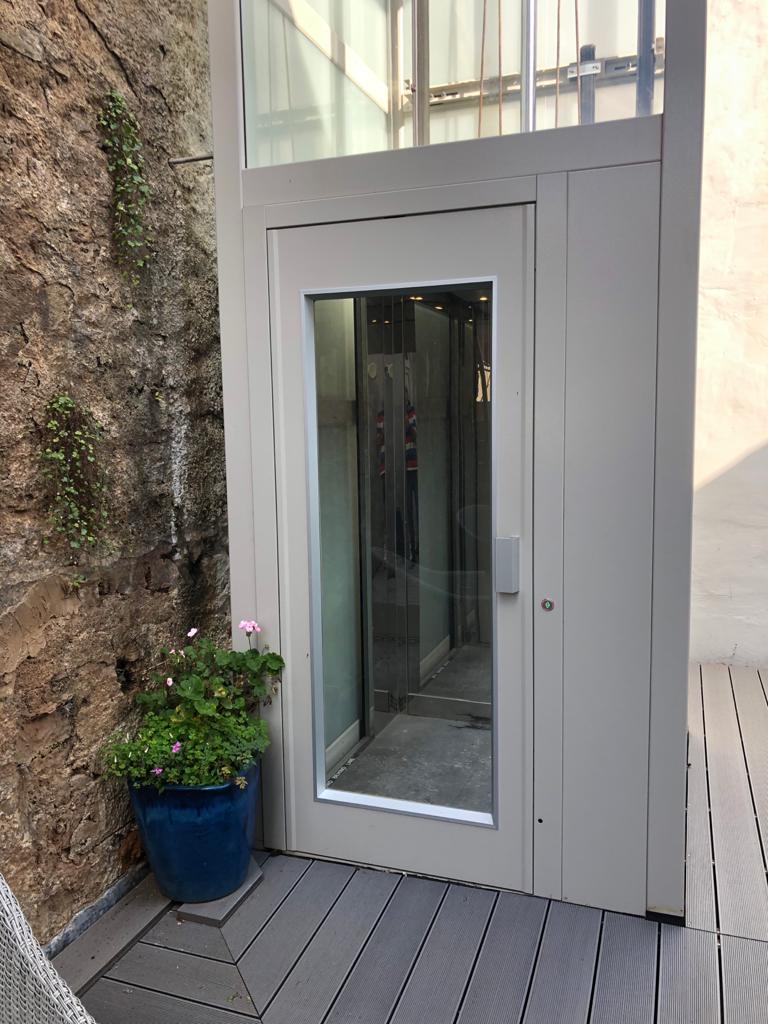 The outdoor home lift in Brixham on the middle floor