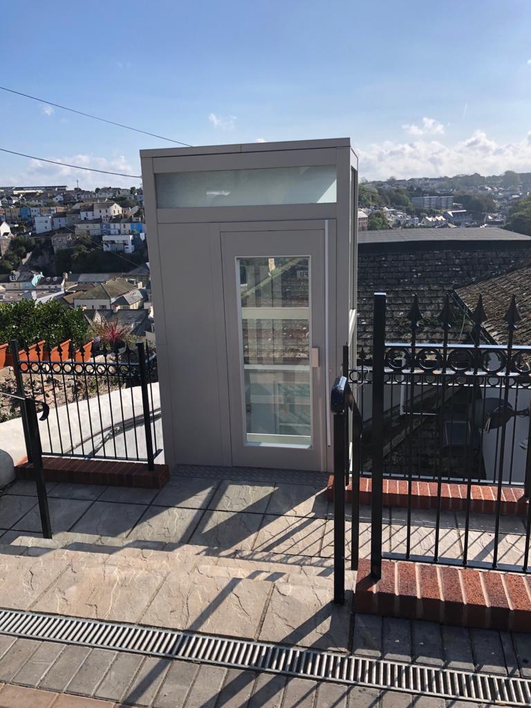 Outdoor glass home lift in Brixham on the top floor