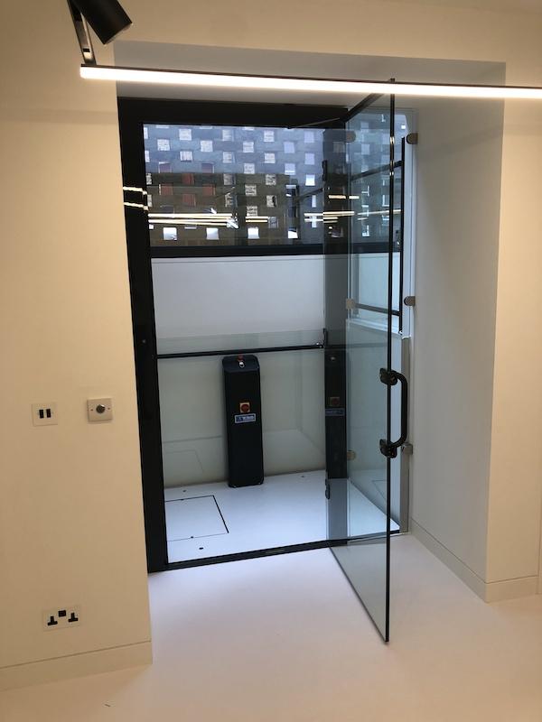 The glass platform lift with the door open
