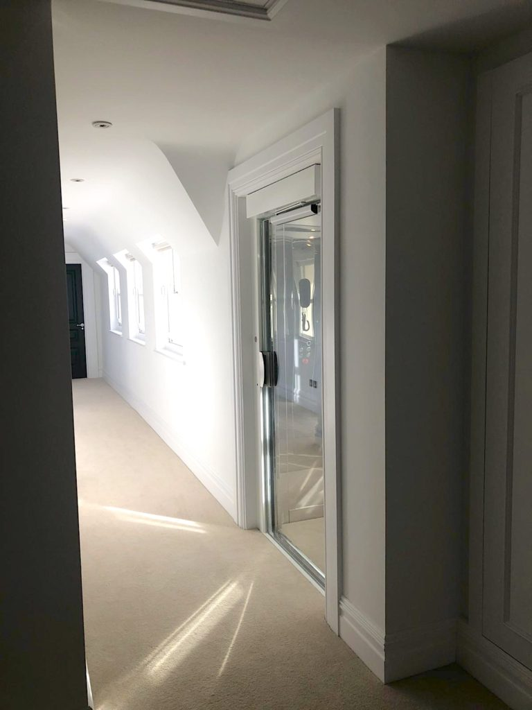 The glass doors allow light to flood into the landing