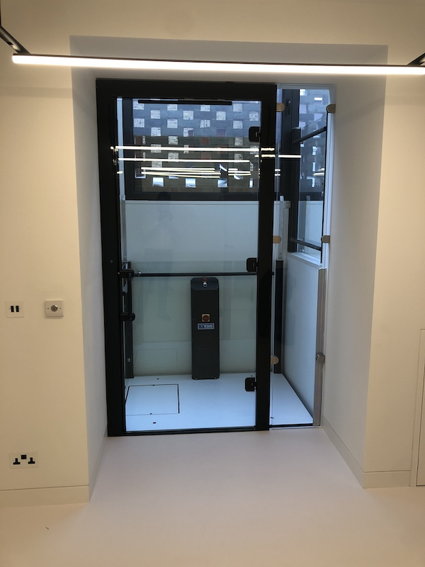 Bespoke glass lift with 90º entry at Eardley House
