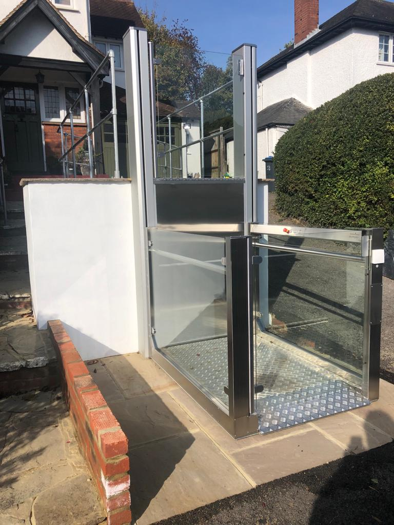 The platform lift features frameless glass side panels and gates