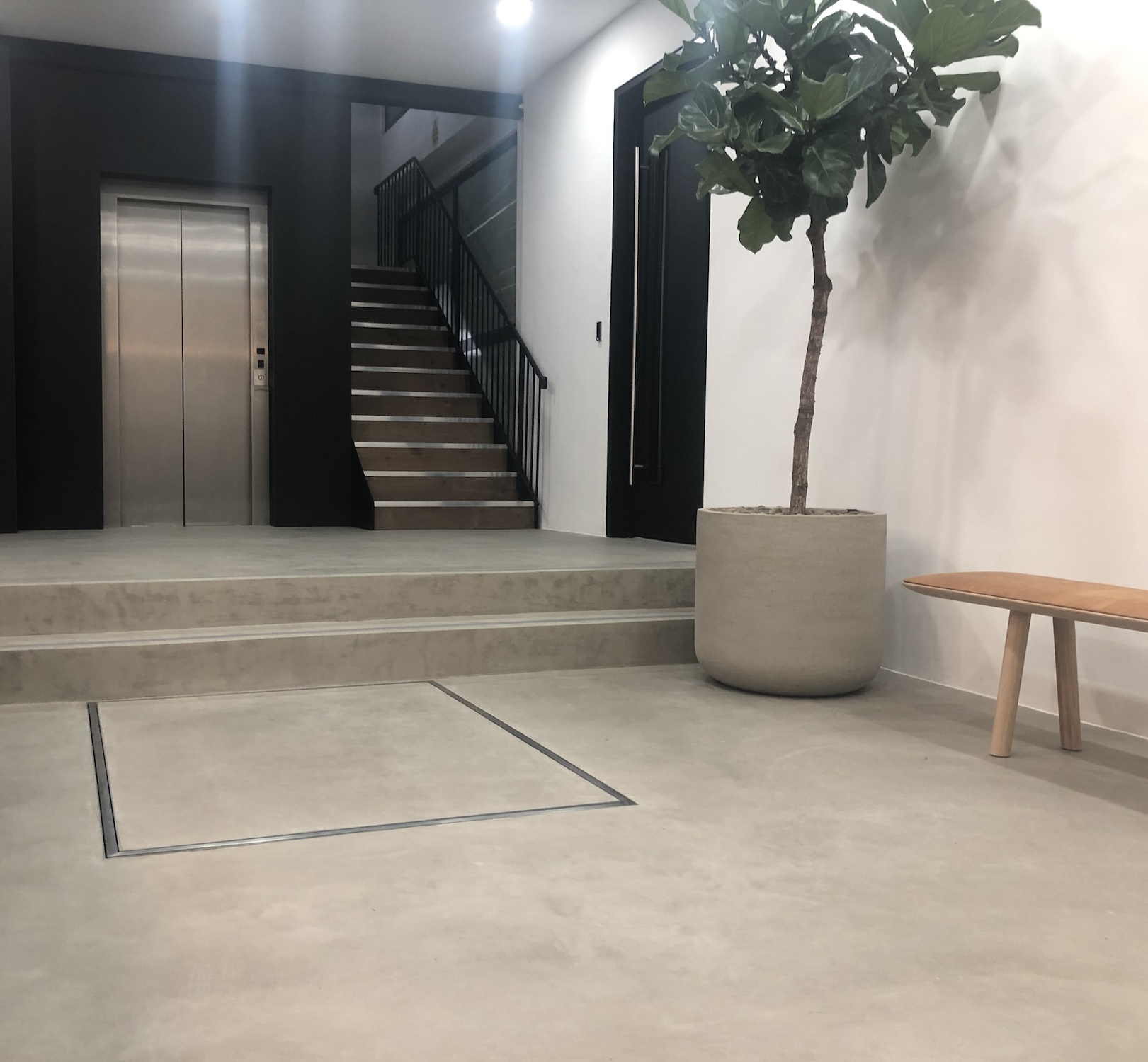 Hidden cantilever lift at 12-16 Laystall Street