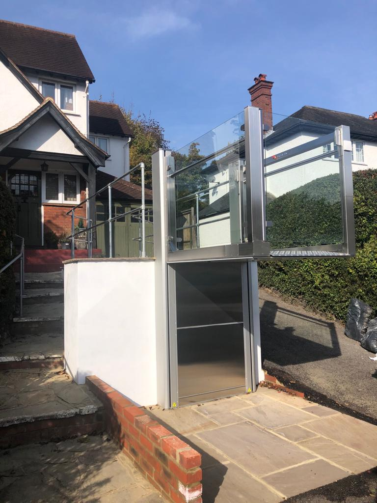The outdoor wheelchair lift in Purley features stainless steel and anodised aluminium finishes