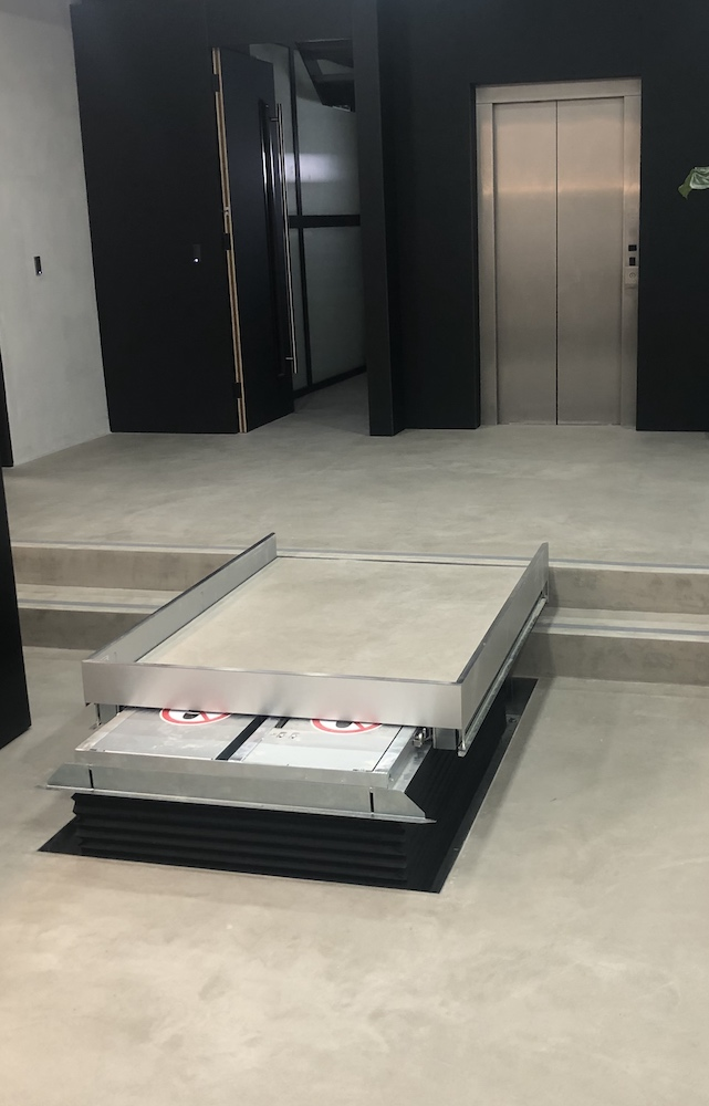 The hidden lift is controlled via hand held remote controls at reception
