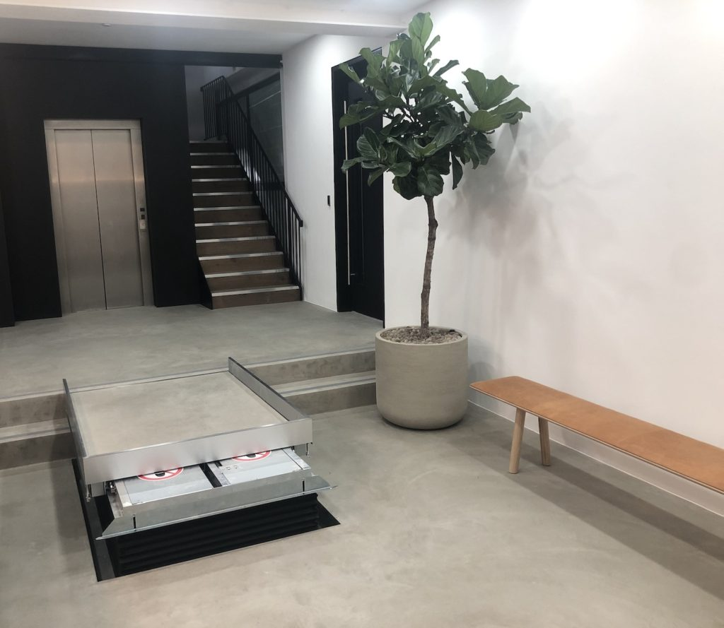 Traversing lift for wheelchairs in a commercial office in London