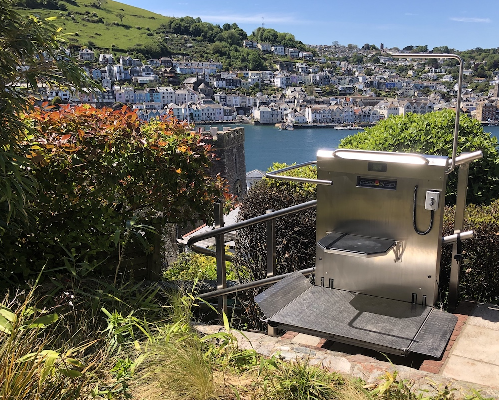 Inclined platform lift in Kingswear, Devon with a view of Dartmouth