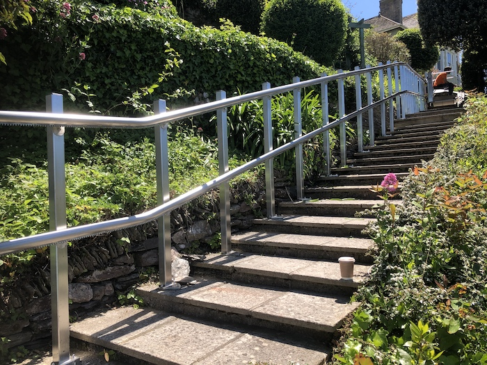 The inclined platform lift in Kingswear is supported by stainless steel stanchions